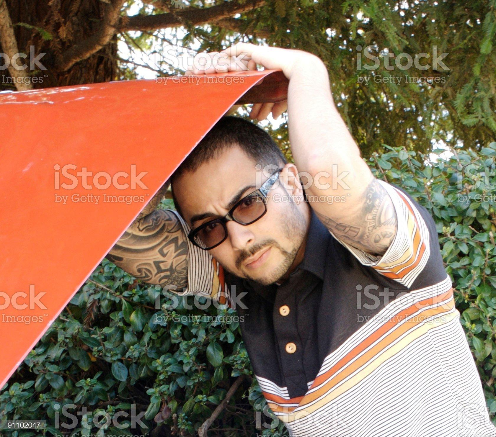Hispanic male working on his car royalty-free stock photo