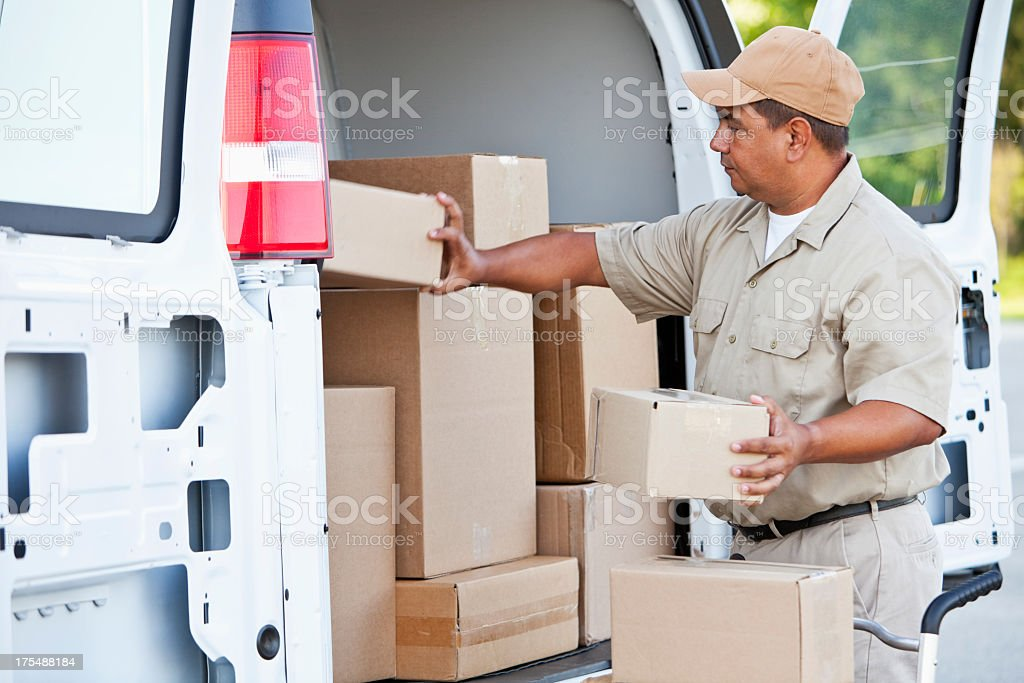 Hispanic man delivering packages royalty-free stock photo