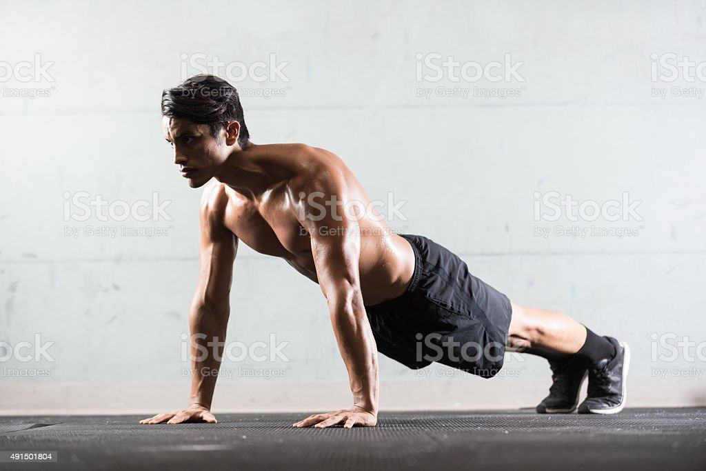 Hispanic Man Doing Push Ups stock photo