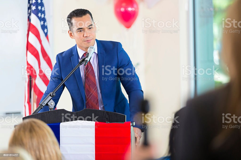 Hispanic man giving speech while running for political office stock photo