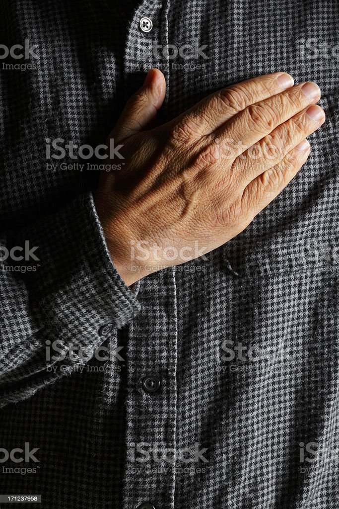 Hispanic man placing his hand over his heart stock photo