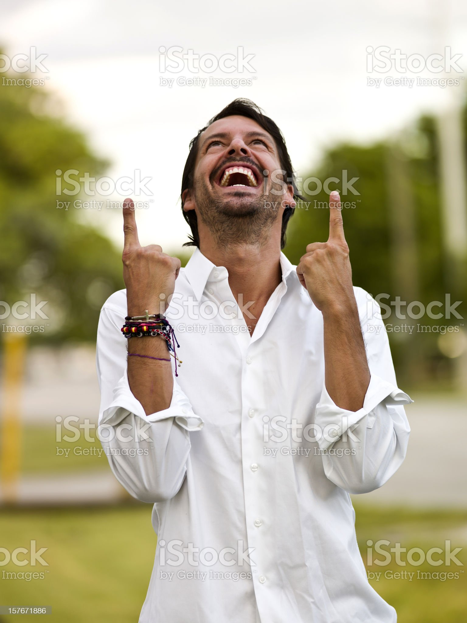 Hispanic Man pointing up royalty-free stock photo