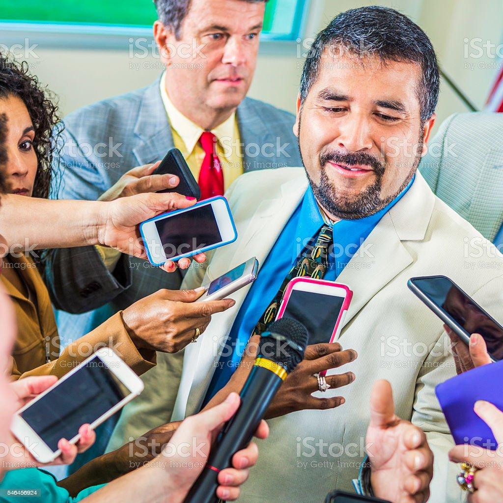Hispanic man speaks to media stock photo