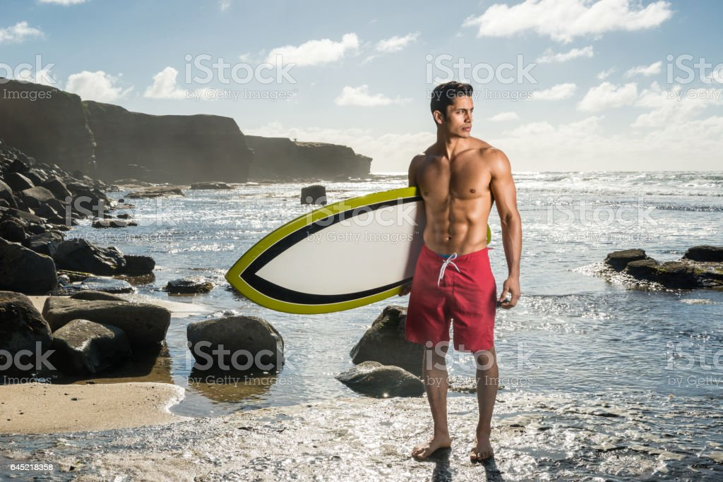 Hispanic Man With His Surboard stock photo