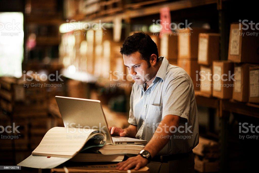 Hispanic Manager in Warehouse stock photo