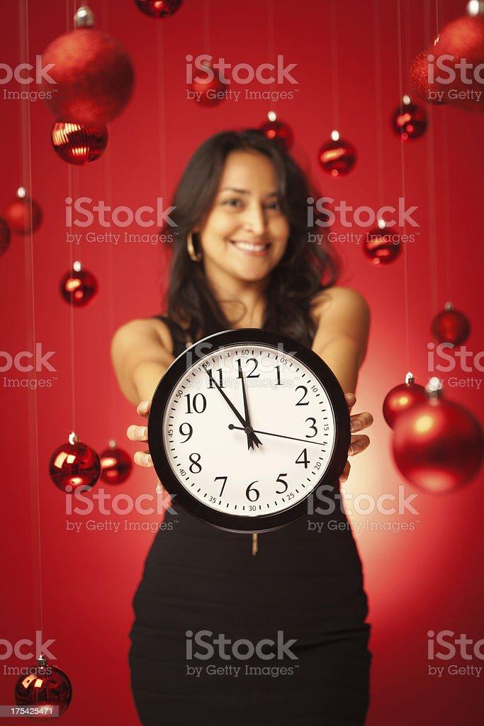 Hispanic Model Holding Christmas Shopping Deadline Time Clock Vt royalty-free stock photo