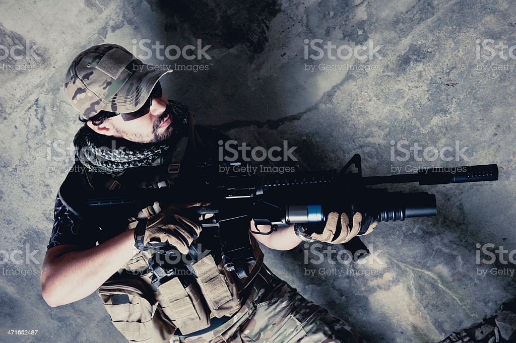 Hispanic Modern Contractor Soldier Loading Grenade on M203 Launcher royalty-free stock photo