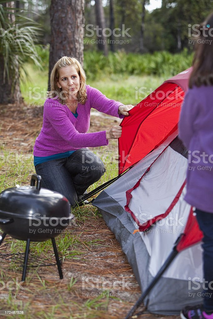 Hispanic mother and daughter camping stock photo