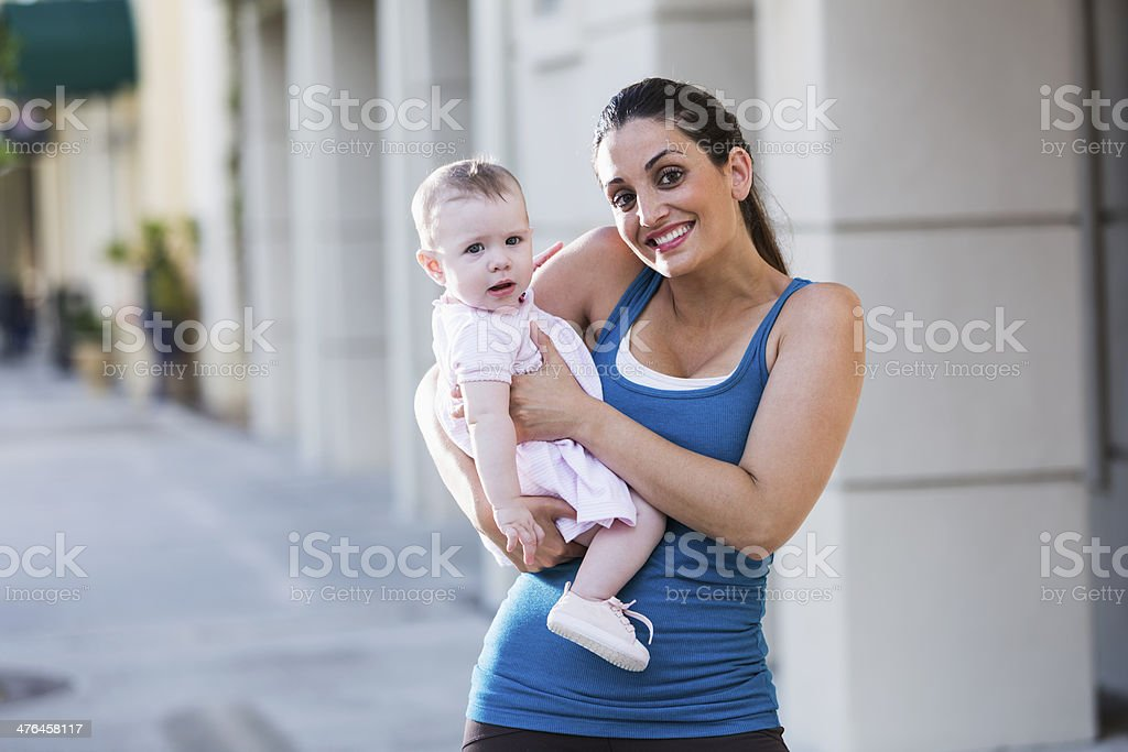 Hispanic mother holding baby royalty-free stock photo