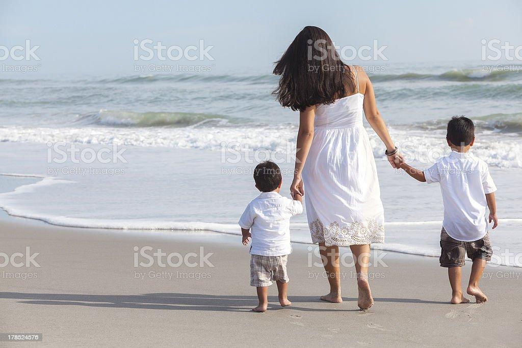 Hispanic Mother & Two Boy Children Family on Beach stock photo