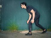 Hispanic Runner On A Green Background