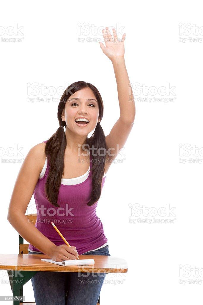 Hispanic schoolgirl raised hand in class royalty-free stock photo