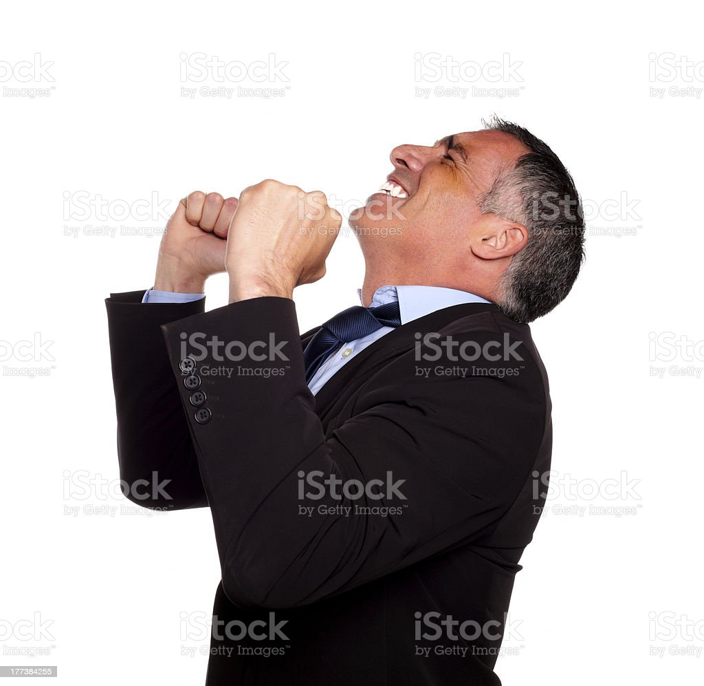 Hispanic senior broker celebrating royalty-free stock photo
