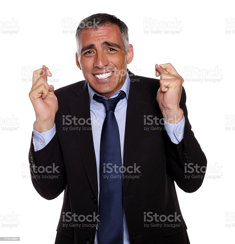 Hispanic senior man praying for luck royalty-free stock photo