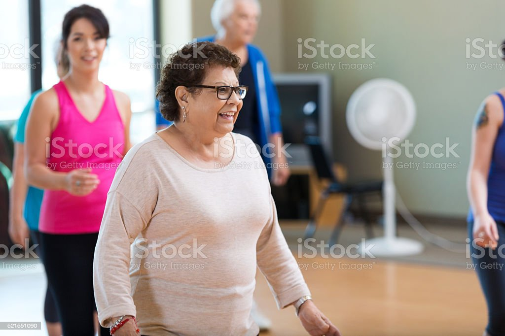 Hispanic senior woman enjoys dance class stock photo