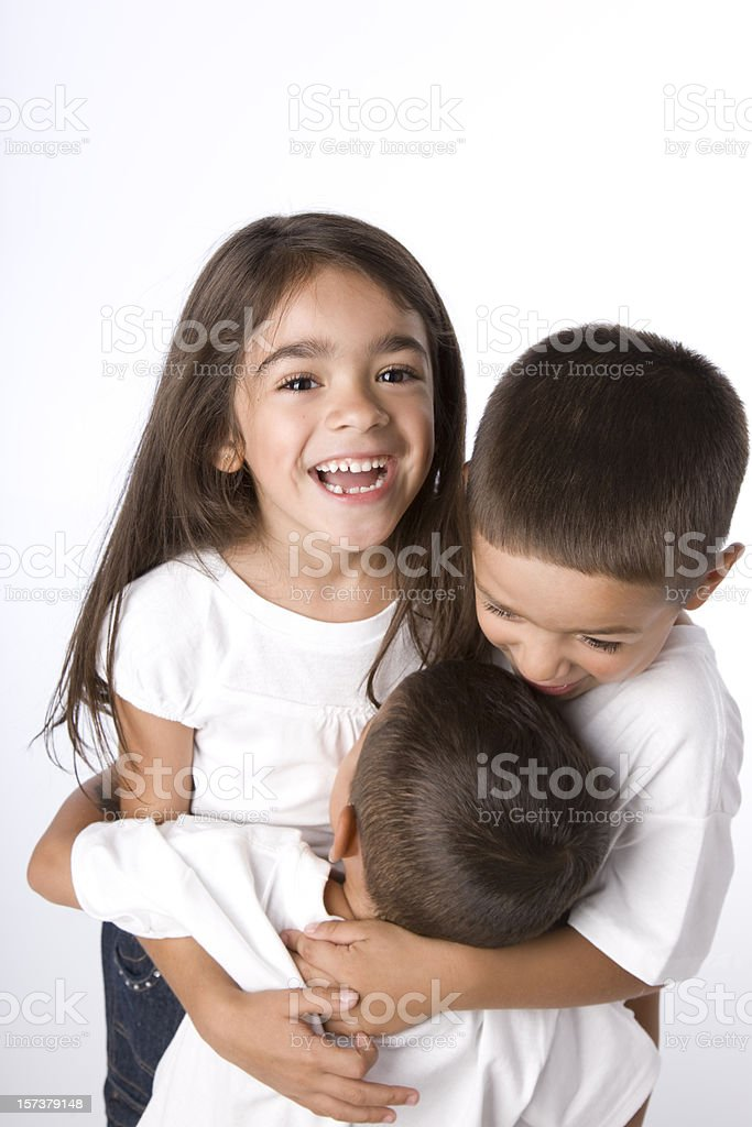 Hispanic Siblings Embrace royalty-free stock photo