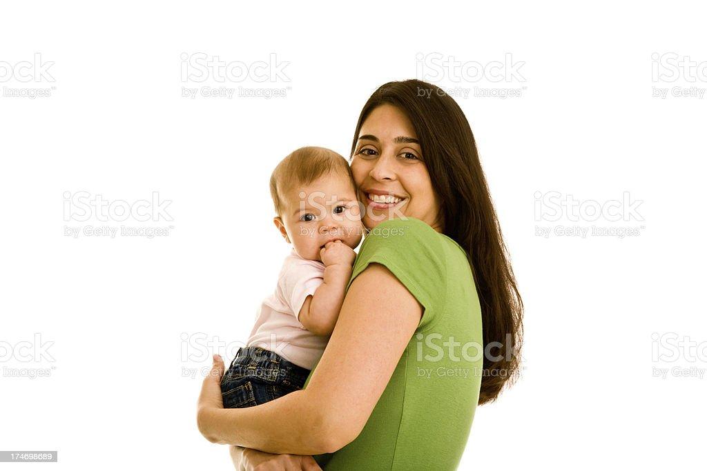 Hispanic smiling female hugging infant looking at camera royalty-free stock photo