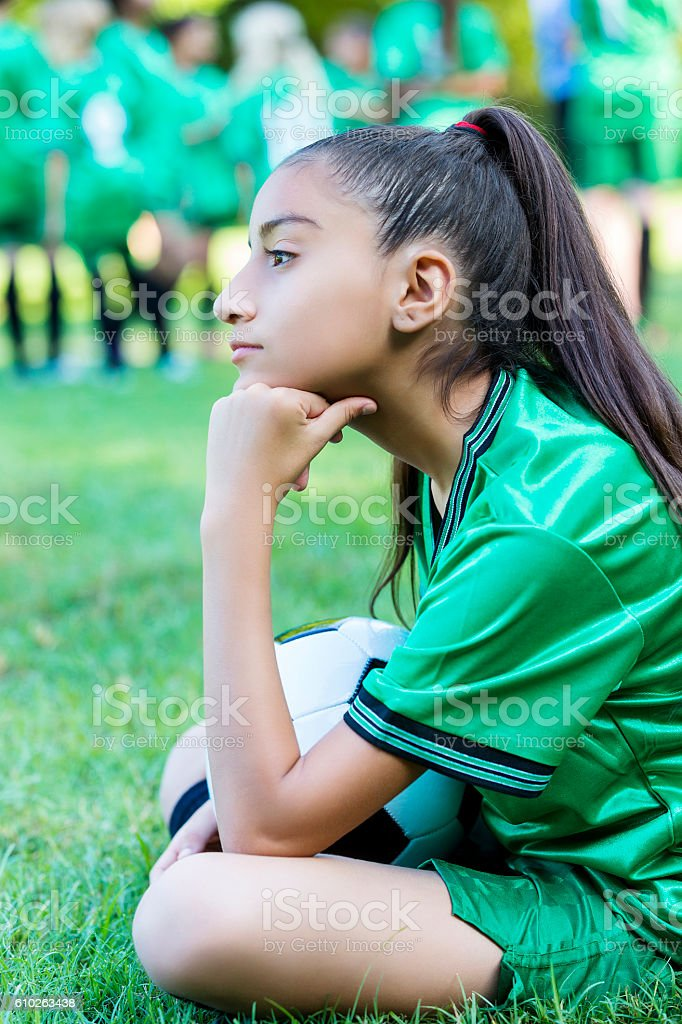 Hispanic soccer athlete waits for game to start stock photo