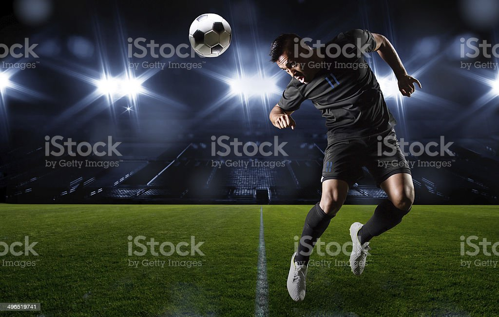 Hispanic Soccer Player heading the ball stock photo