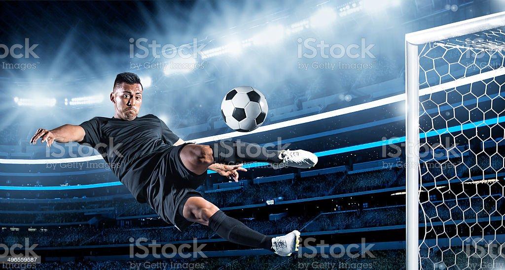 Hispanic Soccer Player kicking the ball stock photo