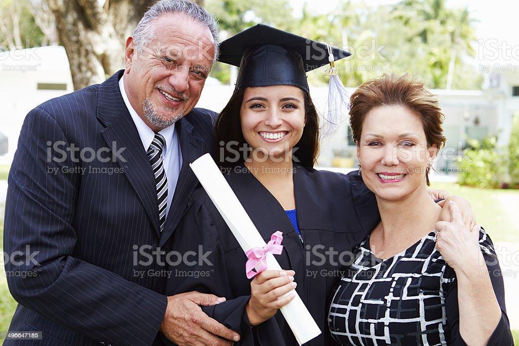 Hispanic Student And Parents Celebrate Graduation stock photo