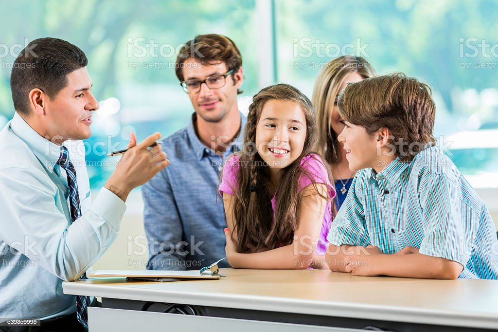 Hispanic Teacher meeting with Family stock photo