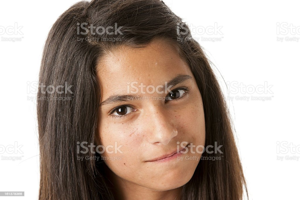 Hispanic Teenage Girl with Look of Determination Closeup Headshot royalty-free stock photo