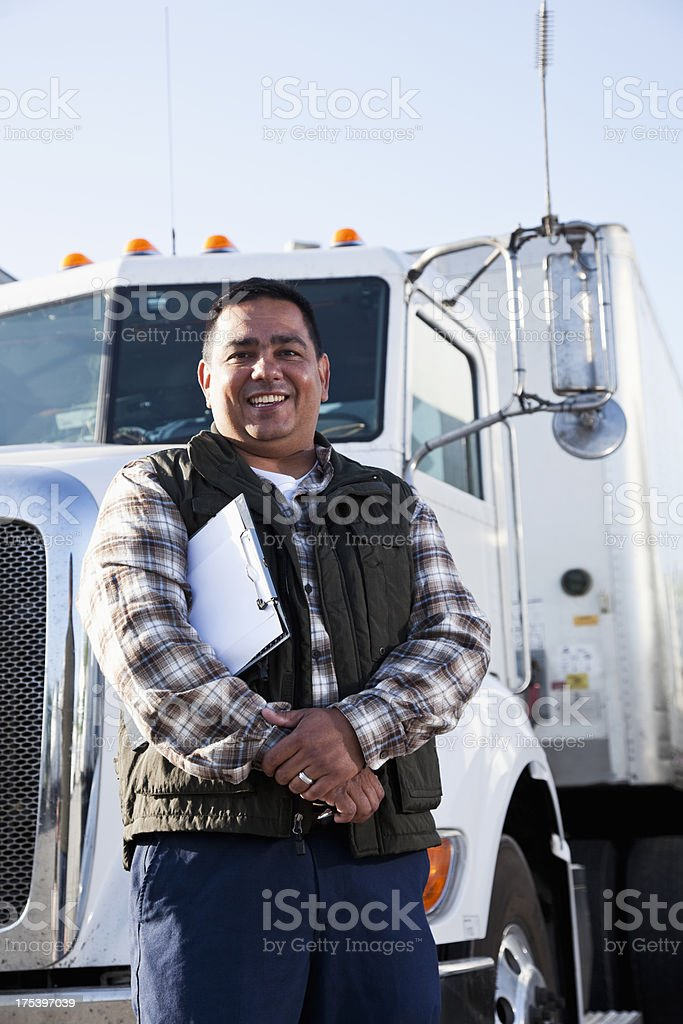 Hispanic truck driver with clipboard royalty-free stock photo