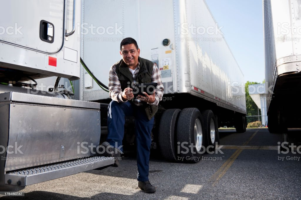 Hispanic truck driver with digital tablet royalty-free stock photo