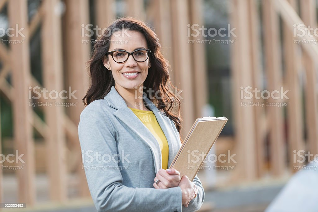Hispanic woman at construction site stock photo