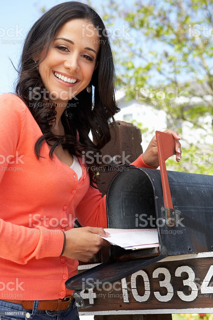 Hispanic Woman Checking Mailbox royalty-free stock photo