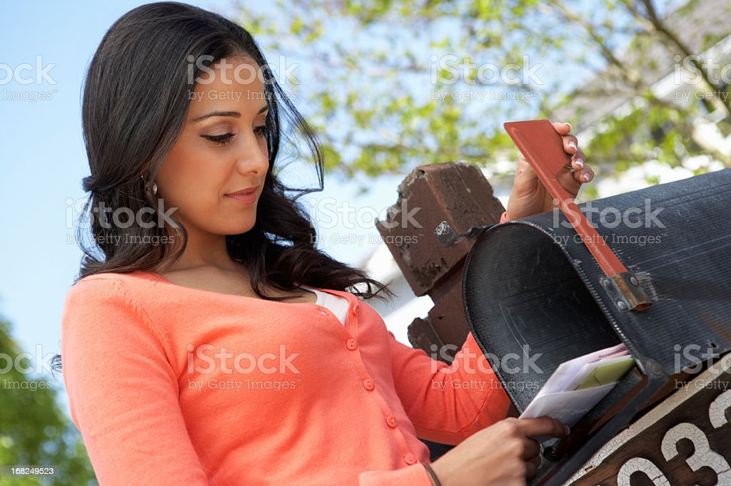 Hispanic Woman Checking Mailbox stock photo