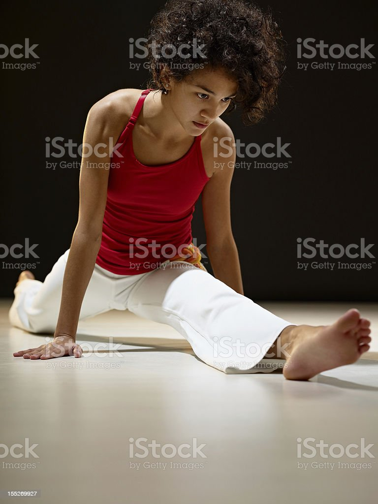 hispanic woman doing leg splits royalty-free stock photo