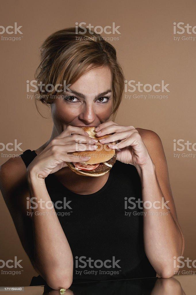 Hispanic Woman Having a Hamburger royalty-free stock photo