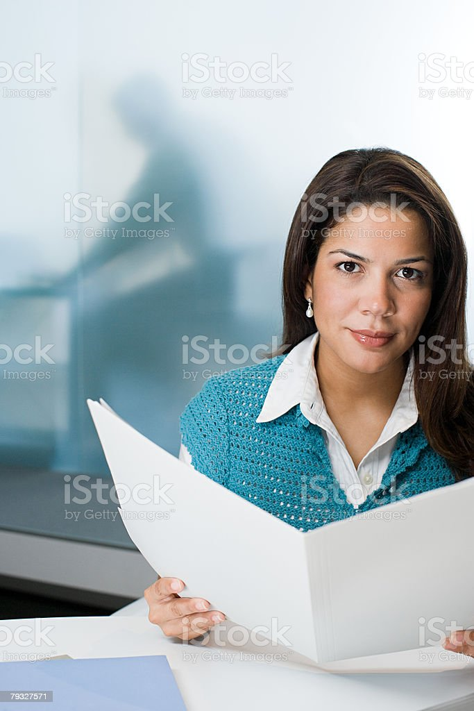 Hispanic woman holding a document royalty-free stock photo