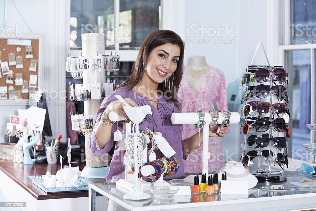 Hispanic woman in a boutique stock photo
