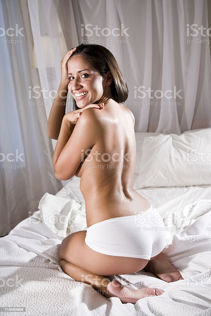 Hispanic woman in bed wearing underwear royalty-free stock photo