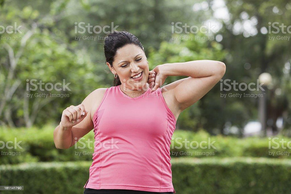 Hispanic woman in park royalty-free stock photo