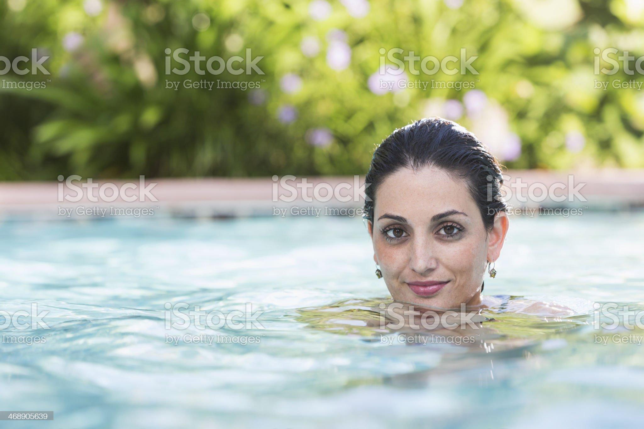Hispanic woman in swimming pool royalty-free stock photo