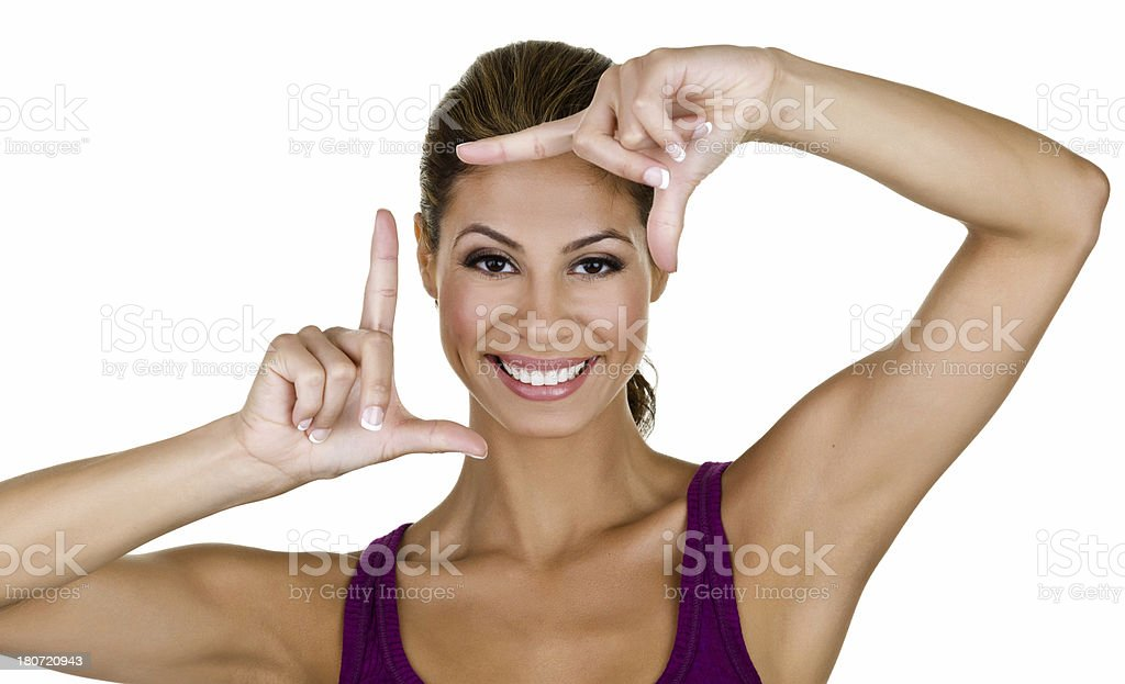 Hispanic woman looking through finger frame royalty-free stock photo