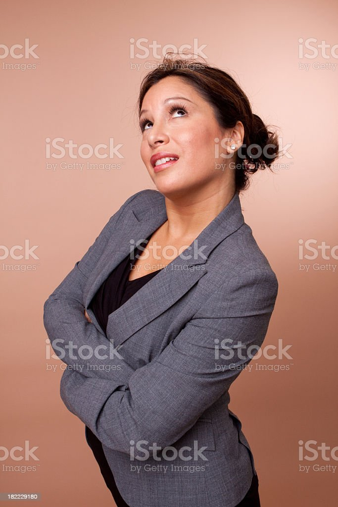 Hispanic Woman Looking Up royalty-free stock photo