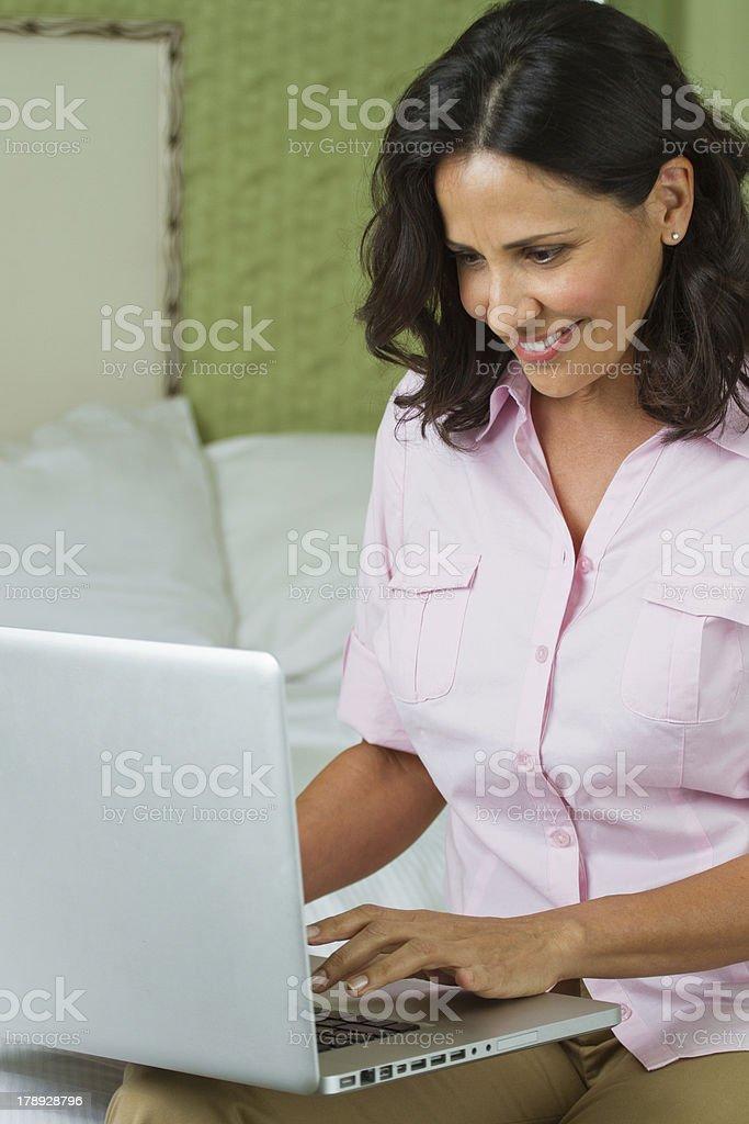 Hispanic woman on the computer royalty-free stock photo