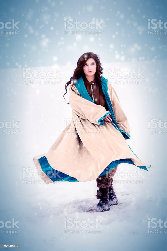 Hispanic Woman Playing In A Snow Storm stock photo