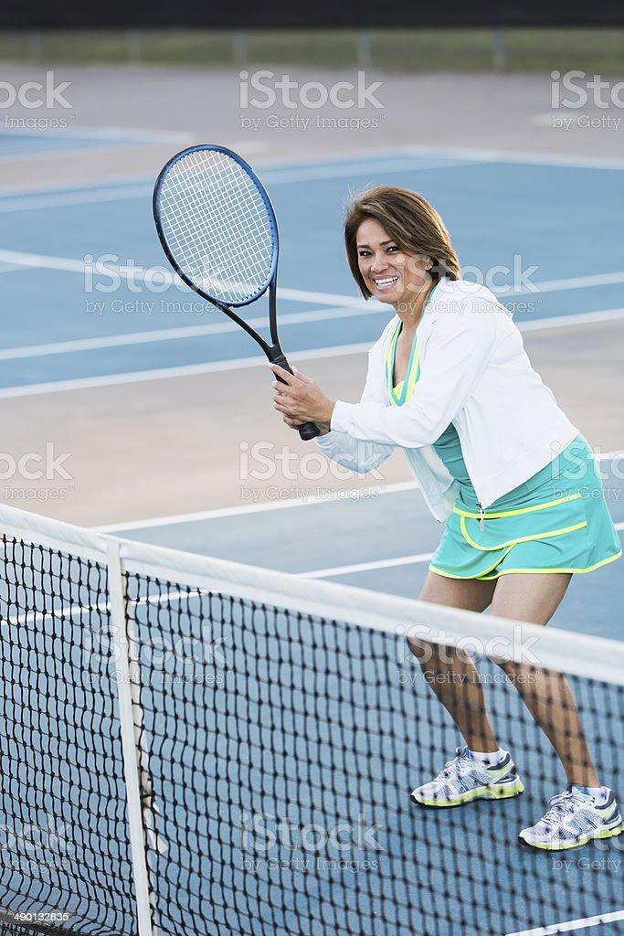Hispanic woman playing tennis royalty-free stock photo