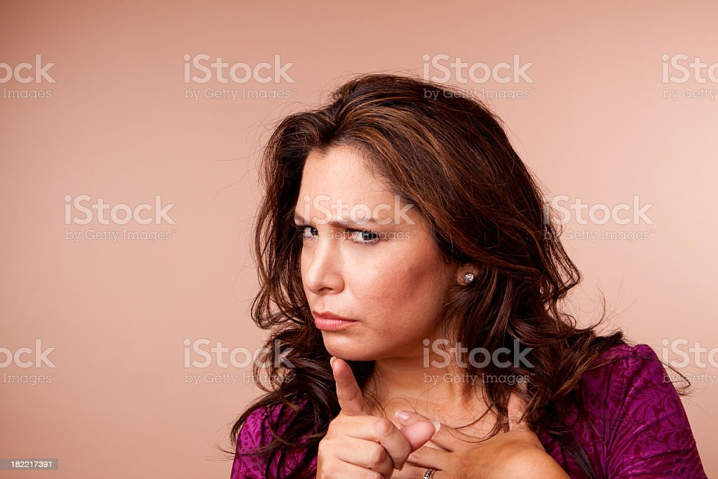 Hispanic Woman Pointing stock photo