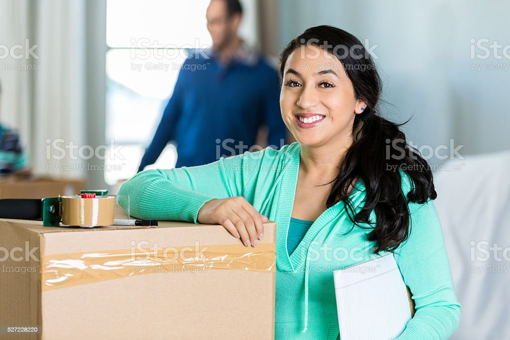 Hispanic woman preparing to move to new home stock photo