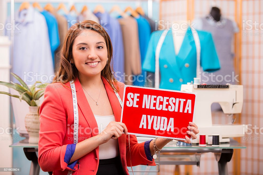 Hispanic woman, small business owner. Tailor, fashion designer, boutique. stock photo
