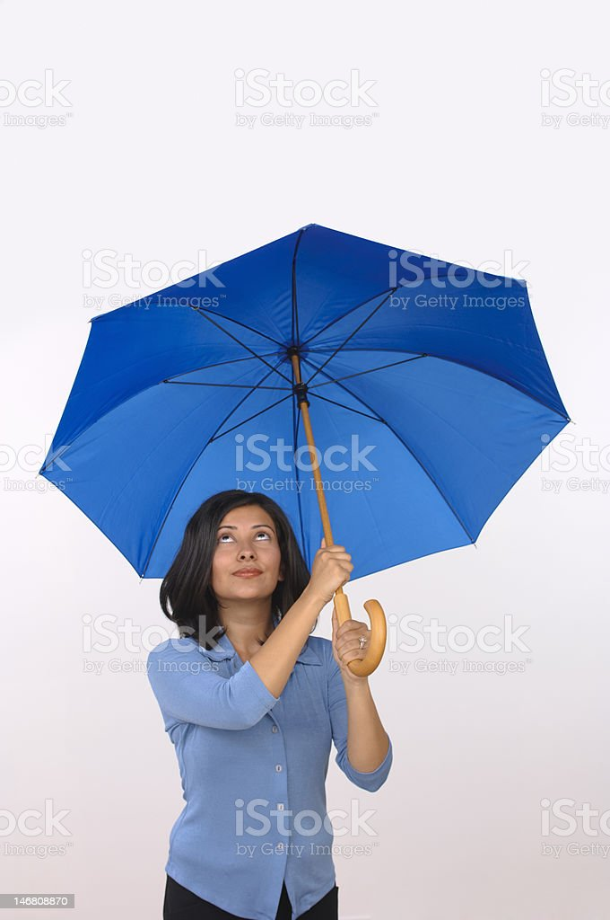 Hispanic woman with a worried look under an umbrella royalty-free stock photo