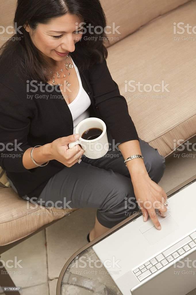 Hispanic Woman with Coffee and Laptop royalty-free stock photo