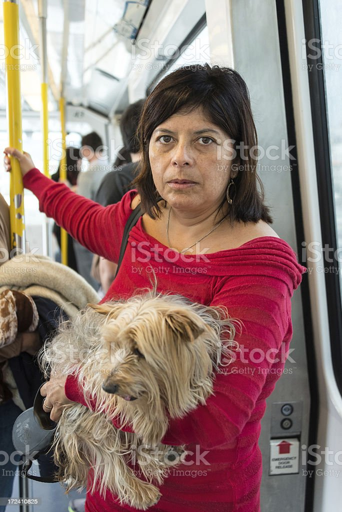 Hispanic woman with her dog royalty-free stock photo